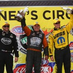 Shawn Langdon (left), Johnny Gray (center) and Jeg Coughlin Jr. celebrate after winning during the NHRA Mello Yello Drag Racing Series Kansas Nationals last Sunday at Heartland Park Topeka. (Ivan Veldhuzien Photo)