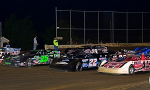 The World of Outlaws Late Model Series lines up four-wide prior to the start of a 2013 feature at Wayne County Speedway in Orrville, Ohio in 2013. (Joe Secka/JMS Pro Photo)