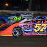 Bub McCool (57J), Chub Frank (1*) and Clint Smith go three-wide past the grandstands at Wayne County Speedway in Ohio Friday night. (Joe Secka/JMS Pro Photo)
