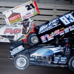Brian Brown (21) battles Tim Kaeding during Saturday's World of Outlaws STP Sprint Car Series feature at Knoxville (Iowa) Raceway. (Ken Simon Photo)