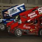 Kyle Larson (1l) and Davey Heskin battle during Saturday's World of Outlaws STP Sprint Car Series event at Knoxville (Iowa) Raceway. (Mark Funderburk Photo)