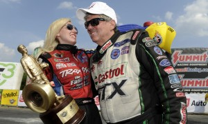 Courtney Force (left) gets a hug from her father John Force after beating him in the NHRA Funny Car class finals at New England Dragway. (NHRA Photo)