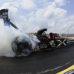Spencer Massey performs a burnout before the final round of the NHRA Top Fuel class last Sunday at New England Dragway in Epping, N.H. (NHRA Photo)
