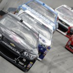 Juan Pablo Montoya (42) leads a pack of cars during Sunday's NASCAR Sprint Cup Series race at Dover (Del.) Int'l Speedway. (HHP/Brian Lawdermilk Photo)