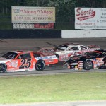 Ross Kenseth (25) battles Jeremy Miller (5) and Bobby Kendall during Saturday's ARCA Midwest Tour race at Dells Raceway Park in Wisconsin Dells, Wis. (Doug Hornickel Photo)
