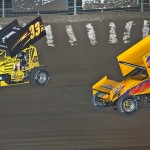 Jac Haudenschild (59) battles his son Sheldon Haudenschild during Friday's UNOH All Star Circuit of Champions event at Limaland Motorsports Park in Lima, Ohio. (Mike Campbell Photo)
