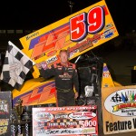 Jac Haudenschild stands in victory lane after winning Friday's UNOH All Star Circuit of Champions event at Limaland Motorsports Park. (Mike Campbell Photo)