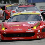 The Ferrari 458 shared by Max Papis and Jeff Segal leads a pack of cars during Saturday's Grand-Am Rolex Sports Car Series event at Belle Isle Park in Detroit. (Al Steinberg Photo)