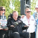 Simon Pagenaud (right) shares victory lane with team co-owners Sam Schmidt (center) and Davey Hamilton (left) Sunday at Belle Isle Park. (Al Steinberg Photo)