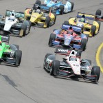 Will Power (12) and James Hinchcliffe (27) lead the IZOD IndyCar Series field at the start of Sunday's event at Iowa Speedway. (Al Steinberg Photo)