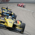 Graham Rahal (15) leads a pack of cars during Sunday's IZOD IndyCar Series Iowa Corn Indy 250 at Iowa Speedway in Newton, Iowa. (Al Steinberg Photo)