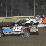 Cody Scott (92) grabs the lead from Ryan Missler during UMP late model action at Attica (Ohio) Raceway Park. (Action photo)