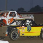 Andy Keegan (0) battles Dustin Keegan during dirt truck competition at Attica (Ohio) Raceway Park. (Action photo)