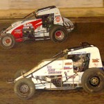 Early battle during the BOSS wingless sprint car feature at Pennsylvania's Mercer Raceway Park as eventual winner Tony Beaber (3t) uses the inside lane to pass Dustin Smith. (Hein Brothers photo)