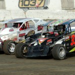 Chuck McKee (33) battles John Lodini during 358 modified action at Orange County Fair Speedway in Middletown, N.Y. (Bruce Bennett photo)