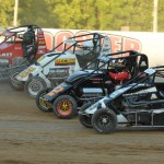 Bryan Clauson, Dave Darland, Davey Ray and Bobby East go four-wide during hot laps at Lincoln Park Speedway in Putnamville, Ind., during Honda USAC National Dirt Midget Series competition. (Dave Heithaus Photo)