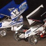 Cole Wood (17w) and eventual race winner Kevin Ramey battle Friday during ASCS Gulf South Region action at Heart O' Texas Speedway in Waco, Texas. (Tom Meredith Photo)