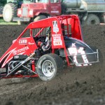 Kyle Larson throws up some dirt during hot laps for Wednesday's Honda USAC National Dirt Midget Series feature at Gas City (Ind.) I-69 Speedway. (Gordon Gill Photo)
