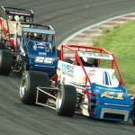 Brian Tyler (21), Bobby East (22) and Chris Windom battle for position during Saturday's Traxxas USAC Silver Crown Series race at Gateway Motorsports Park. (Don Figler Photo)