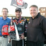 Bobby Santos III (center) stands in victory lane with Gateway Motorsports Park owner Curtis Francois (left) and track general manager Chris Blair. (Don Figler Photo)
