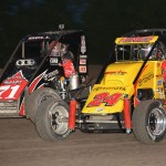 Tracy Hines (24) works to the inside of Christopher Bell during Wednesday's Honda USAC National Dirt Midget Series feature at Gas City (Ind.) I-69 Speedway. (Dave Heithaus Photo)