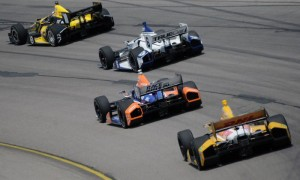 A pack of cars rolls through a corner during the IZOD IndyCar Series race at Iowa Speedway. (Dan Hodges Photo)