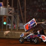 Danny Holtgraver takes the checkered flag at Mercer Raceway Park in Pennsylvania. Holtgraver won 410 and 360 sprint car features on the same night. (Joe Secka/JMS Pro photo)