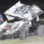 Christopher Bell surveys his damaged sprint car after a late-race crash in Friday's ASCS Gulf South Region event at Golden Triangle Raceway Park in Beaumont, Texas. (RonSkinnerPhotos.com Photo)