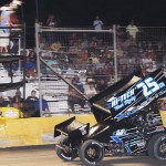 Michael McNeil crosses the finish line to win Friday's ASCS Gulf South Region event at Golden Triangle Raceway Park in Beaumont, Texas. (RonSkinnerPhotos.com Photo)