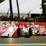 The No. 42 Zytek Z11SN - Nissan LMP2 driven by Lucas Ordonez, Jann Mardenborough and Michael Krumm leads a pack of cars during the 24 Hours of Le Mans. (Pete Richards Photo)