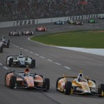 Ryan Hunter-Reay (1) and Charlie Kimball (83) lead a pack of cars during Saturday's IZOD IndyCar Series Firestone 550 at Texas Motor Speedway. (IndyCar Photo)