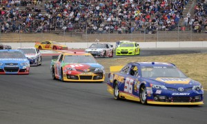 Martin Truex Jr. (56) leads Kyle Busch (18) and the rest of the NASCAR Sprint Cup Series field during Sunday's Toyota/Save Mart 350 at Sonoma (Calif.) Raceway in 2013. (Jerry Jones Photo)