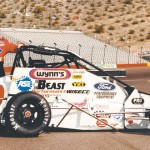 Jason Leffler poses with the Lewis Racing midget at Phoenix Int'l Raceway in 1998. (NSSN Archives Photo)