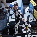 Jimmie Johnson celebrates after winning the Party in the Poconos 400 at Pocono Raceway in June. (NASCAR Photo)