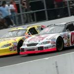 Jason Leffler (00) battles Kenny Wallace at New Hampshire Motor Speedway in 2004. (NASCAR Photo)