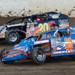 Tommy Beezley (69) and Kody Weisner battle during their modified heat race at Limaland Motorsports Park. (Mike Campbell photo)