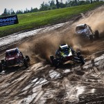 Buggies throw dirt into the air during Sunday's Traxxas TORC Series race at Bark River (Mich.) Int'l Raceway. (Michael Roth Photo)