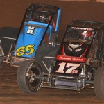 Shane Cottle (65) battles to the outside of Kevin Thomas Jr. en route to victory in Sunday's AMSOIL USAC National Sprint Car Series event at Susquehanna Speedway Park in Newberrytown, Pa. (Dave Heithaus Photo)