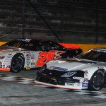Ronnie Bassett Jr. (04) fights off Travis Swaim en route to winning the UARA-STARS late model race at Anderson (S.C.) Speedway. (Drew Hierwarter photo)
