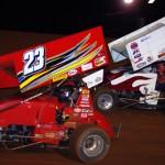 Lance Moss (23) battles Lee Moore during USCS sprint car action at East Alabama Motor Speedway. (Chris Seelman photo)