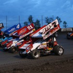 Jason Sides (7s), Paul McMahan (51), Cody Darrah (4) and Daryn Pittman (9) lead the World of Outlaws STP Sprint Car Series in a four-wide salute prior to Saturday's race at Lakeside Speedway in Kansas City, Kan. (Ivan Veldhuizen Photo)