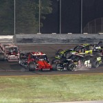 Modifieds scatter in turn one during Friday's NASCAR Whelen Modified Tour event at Stafford Motor Speedway in Stafford Springs, Conn. (Dick Ayers Photo)
