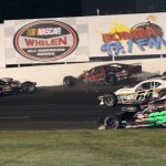 Todd Szegedy (2) and Patrick Emerling (07) tangle in front of a pack of cars during Friday's NASCAR Whelen Modified Tour race at Stafford Motor Speedway in Stafford Springs, Conn. (Dick Ayers Photo)