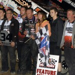Craig Dollansky stands in victory lane with his crew after winning Friday's World of Outlaws STP Sprint Car Series feature at 34 Raceway in Burlington, Iowa. (Mark Funderburk Photo)