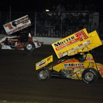 Craig Dollansky (7) and Joey Saldana during Friday's World of Outlaws STP Sprint Car Series event at 34 Raceway in Burlington, Iowa. (Mark Funderburk Photo)