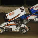 Kaley Gharst (35) battles Jimmy Hurley during Friday's Midwest Open Wheel Ass'n feature at Jacksonville (Ill.) Speedway. (Mark Funderburk Photo)