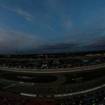 NASCAR K&N Pro Series drivers fly by the grandstands during Friday's East/West combination event at Iowa Speedway. (NASCAR Photo)