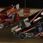 Joey Moughan (17m) battles Paul Nienhiser Friday during Midwest Open Wheel Ass'n action at Jacksonville (Ill.) Speedway. (Mark Funderburk Photo)