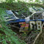 One of several race cars hidden away in Dale Earnhardt Jr.'s race car graveyard. (Ralph Sheheen Photo)