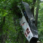 You won't find just NASCAR race cars in Dale Earnhardt Jr.'s race car graveyard. This former Penske IndyCar can be found hanging from one of the tree's on the property. (Ralph Sheheen Photo)